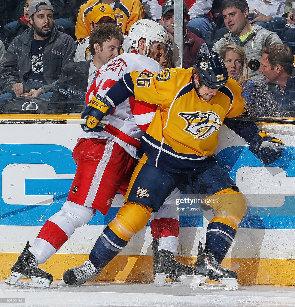 <a gi-track='captionPersonalityLinkClicked' href=/galleries/search?phrase=Matt+Hendricks&family=editorial&specificpeople=4537275 ng-click='$event.stopPropagation()'>Matt Hendricks</a> #26 of the Nashville Predators battles for the puck and <a gi-track='captionPersonalityLinkClicked' href=/galleries/search?phrase=Brian+Lashoff&family=editorial&specificpeople=5529056 ng-click='$event.stopPropagation()'>Brian Lashoff</a> #23 of the Detroit Red Wings at Bridgestone Arena on December 30, 2013 in Nashville, Tennessee.