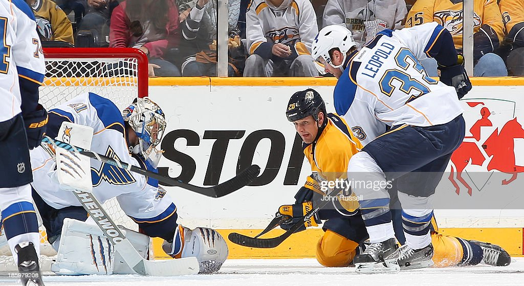 <a gi-track='captionPersonalityLinkClicked' href=/galleries/search?phrase=Matt+Hendricks&family=editorial&specificpeople=4537275 ng-click='$event.stopPropagation()'>Matt Hendricks</a> #26 of the Nashville Predators shovels the puck on net against <a gi-track='captionPersonalityLinkClicked' href=/galleries/search?phrase=Jaroslav+Halak&family=editorial&specificpeople=2285591 ng-click='$event.stopPropagation()'>Jaroslav Halak</a> #41 of the St. Louis Blues as Blues <a gi-track='captionPersonalityLinkClicked' href=/galleries/search?phrase=Jordan+Leopold&family=editorial&specificpeople=201885 ng-click='$event.stopPropagation()'>Jordan Leopold</a> #33 defends at Bridgestone Arena on October 26, 2013 in Nashville, Tennessee.