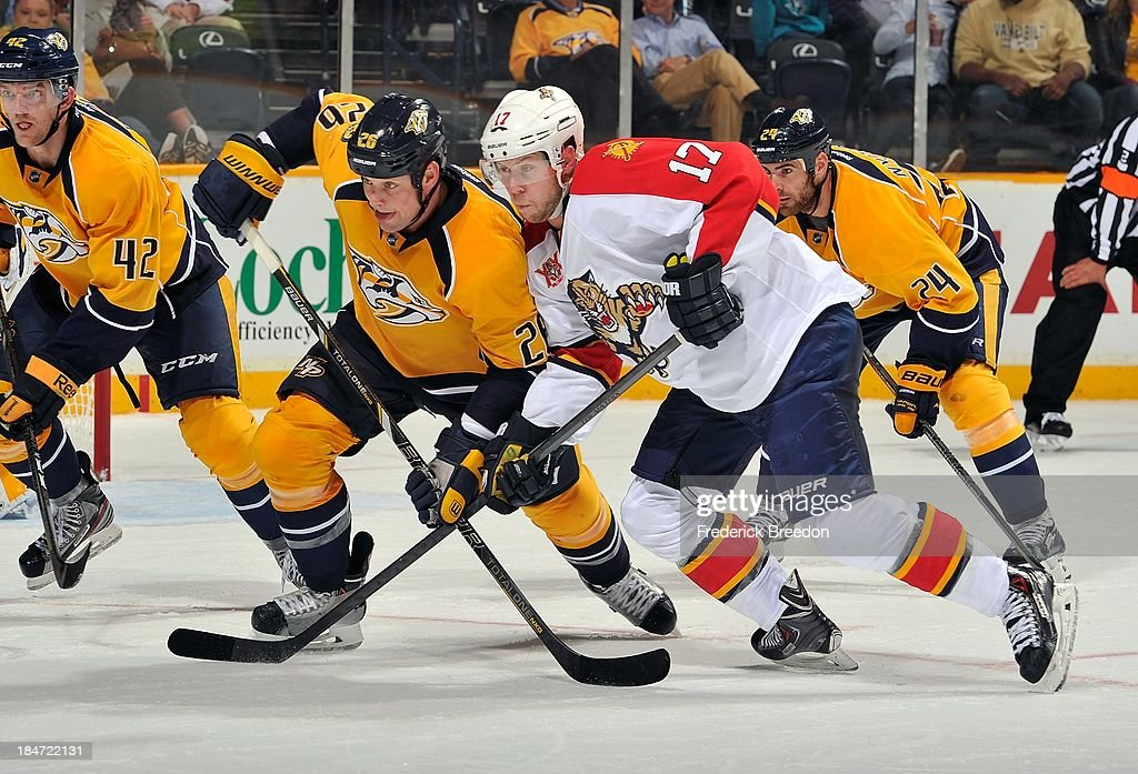 <a gi-track='captionPersonalityLinkClicked' href=/galleries/search?phrase=Matt+Hendricks&family=editorial&specificpeople=4537275 ng-click='$event.stopPropagation()'>Matt Hendricks</a> #26 of the Nashville Predators skates against Jesse Winchester #17 of the Florida Panthers at Bridgestone Arena on October 15, 2013 in Nashville, Tennessee.