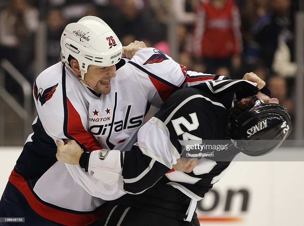 Matt Hendricks of the Washington Capitals and Colin Fraser of the Los Angeles Kings fight during the first period at the Staples Center on January 9...