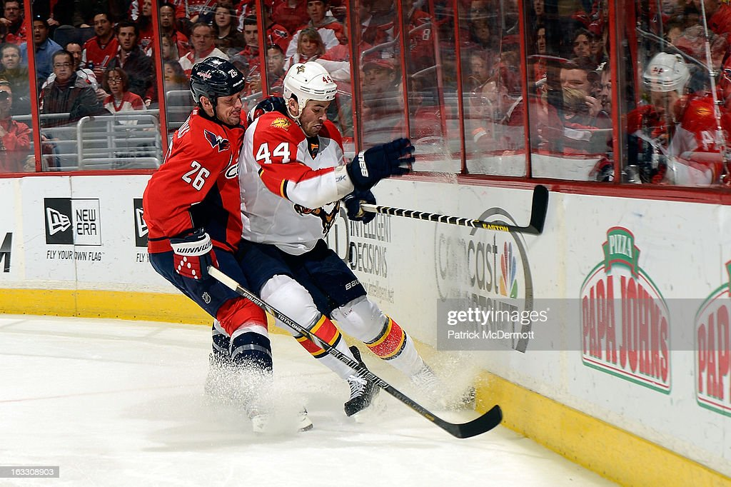 <a gi-track='captionPersonalityLinkClicked' href=/galleries/search?phrase=Matt+Hendricks&family=editorial&specificpeople=4537275 ng-click='$event.stopPropagation()'>Matt Hendricks</a> #26 of the Washington Capitals battles for the puck against <a gi-track='captionPersonalityLinkClicked' href=/galleries/search?phrase=Erik+Gudbranson&family=editorial&specificpeople=5741800 ng-click='$event.stopPropagation()'>Erik Gudbranson</a> #44 of the Florida Panthers during an NHL game at Verizon Center on March 7, 2013 in Washington, DC.