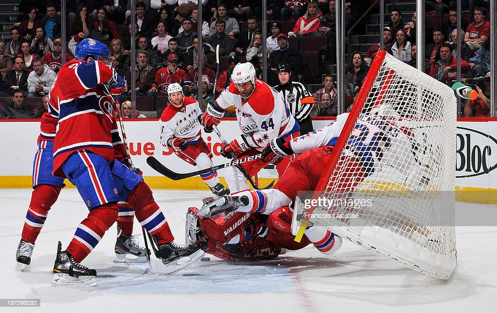 Matt Hendricks of the Washington Capitals falls into the net during the NHL game against the Montreal Canadiens on January 18 2012 at the Bell Centre...