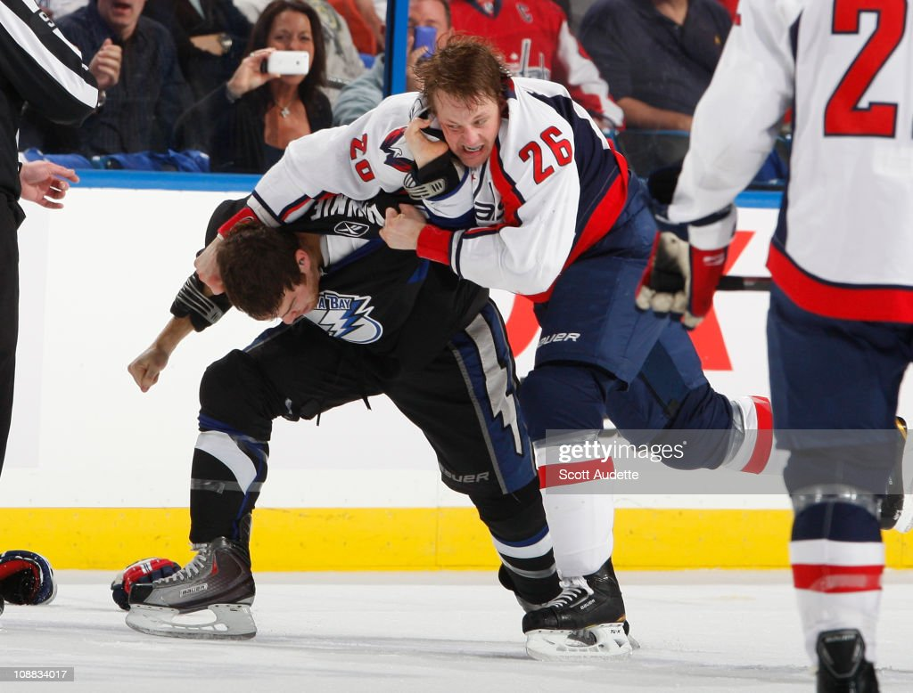 Matt Hendricks #26 of the Washington Capitals fights <a gi-track='captionPersonalityLinkClicked' href=/galleries/search?phrase=Steve+Downie&family=editorial&specificpeople=714514 ng-click='$event.stopPropagation()'>Steve Downie</a> #9 of the Tampa Bay Lightning during the first period at the St. Pete Times Forum on February 4, 2011 in Tampa, Florida.