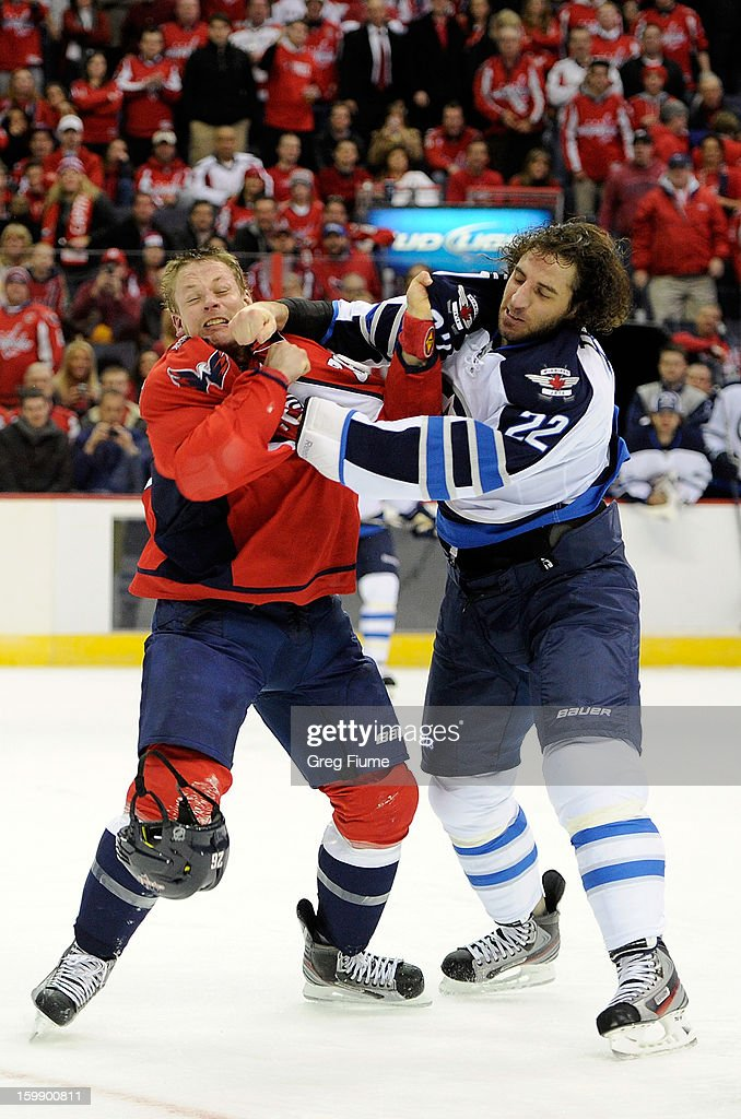 <a gi-track='captionPersonalityLinkClicked' href=/galleries/search?phrase=Matt+Hendricks&family=editorial&specificpeople=4537275 ng-click='$event.stopPropagation()'>Matt Hendricks</a> #26 of the Washington Capitals fights with <a gi-track='captionPersonalityLinkClicked' href=/galleries/search?phrase=Chris+Thorburn&family=editorial&specificpeople=2222066 ng-click='$event.stopPropagation()'>Chris Thorburn</a> #22 of the Winnipeg Jets at the the Verizon Center on January 22, 2013 in Washington, DC.