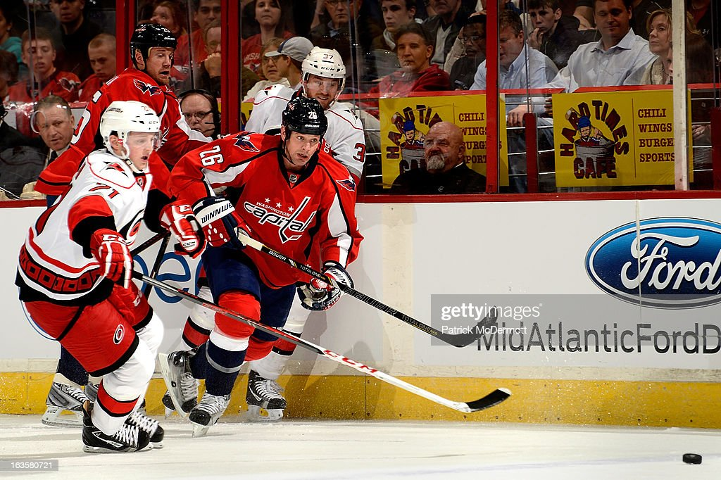 <a gi-track='captionPersonalityLinkClicked' href=/galleries/search?phrase=Matt+Hendricks&family=editorial&specificpeople=4537275 ng-click='$event.stopPropagation()'>Matt Hendricks</a> #26 of the Washington Capitals goes after a loose puck during an NHL game against the Carolina Hurricanes at Verizon Center on March 12, 2013 in Washington, DC.