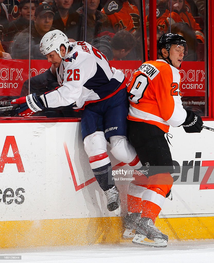 <a gi-track='captionPersonalityLinkClicked' href=/galleries/search?phrase=Matt+Hendricks&family=editorial&specificpeople=4537275 ng-click='$event.stopPropagation()'>Matt Hendricks</a> #26 of the Washington Capitals tries to check Erik Gustafsson #29 of the Philadelphia Flyers in the second period of an NHL hockey game at Wells Fargo Center on March 31, 2013 in Philadelphia, Pennsylvania.