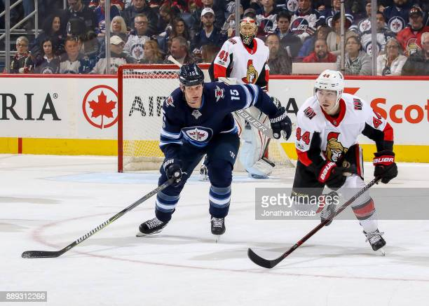 Matt Hendricks of the Winnipeg Jets and JeanGabriel Pageau of the Ottawa Senators follow the play during third period action at the Bell MTS Place on...