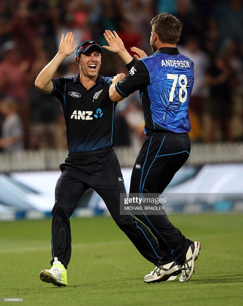 Matt Henry (L) and Cory Anderson (R) of New Zealand celebrate the wicket of John Hastings of Australia during the third one-day international cricket match between New Zealand and Australia at Seddon Park in Hamilton on February 8, 2016.   AFP PHOTO / MICHAEL BRADLEY / AFP / MICHAEL BRADLEY