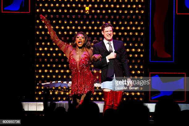 Matt Henry and David Hunter bow at the curtain call during the 1st birthday performance of 'Kinky Boots' at Adelphi Theatre on September 8 2016 in...