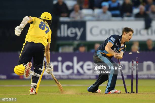 Matt Henry of Derbyshire Falcons takes the wicket of Kyle Abbott of Hampshire during the NatWest T20 Blast at The 3aaa County Ground on August 22...