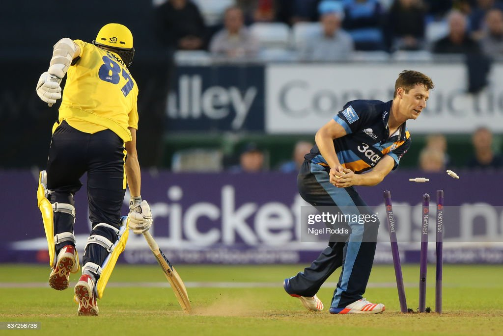 Matt Henry (R) of Derbyshire Falcons takes the wicket of Kyle Abbott of Hampshire during the NatWest T20 Blast at The 3aaa County Ground on August 22, 2017 in Derby, England.