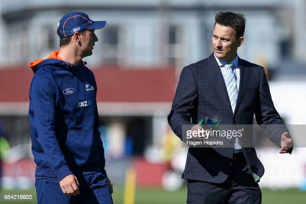 Matt Henry of New Zealand speaks to former New Zealand player Shane Bond during day two of the test match between New Zealand and South Africa at...