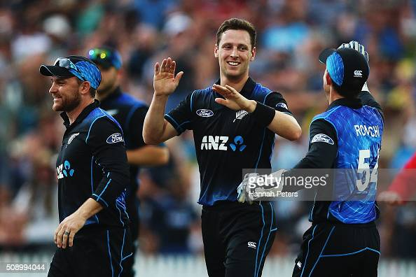 Matt Henry of the Black Caps celebrates the wicket of David Warner of Australia during the 3rd One Day International cricket match between the New...