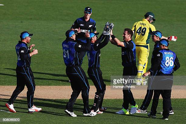 Matt Henry of the Black Caps celebrates the wicket of Steve Smith of Australia during the One Day International match between New Zealand and...