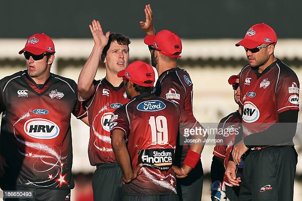 Matt Henry of the Canterbury Wizards celebrates a wicket with teammates during the HRV Twenty20 match between Canterbury Wizards and Otago Volts on...