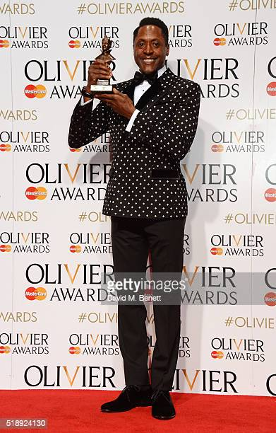 Matt Henry winner of the Best Actor in a Musical for 'Kinky Boots' poses in the Winners Room at The Olivier Awards with Mastercard at The Royal Opera...