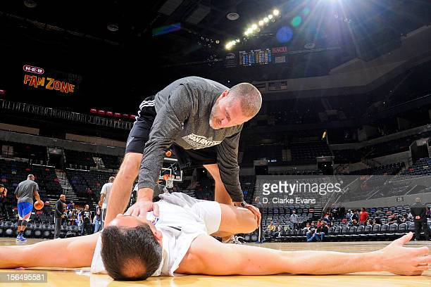 Matt Herring strength and conditioning coach for the San Antonio Spurs works with Manu Ginobili before a game against the New York Knicks on November...