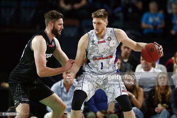 Matt Hodgson of Adelaide backs into Alex Pledger of New Zealand during the round four NBL match between the New Zealand Breakers and the Adelaide...