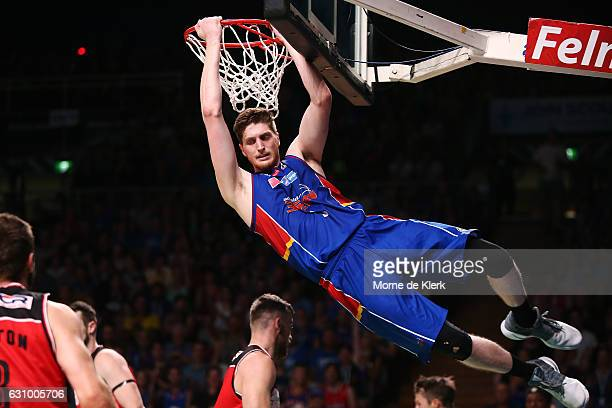 Matt Hodgson of the Adelaide 36ers dunks the ball during the round 14 NBL match between the Adelaide 36ers and the Illawarra Hawks at Titanium...