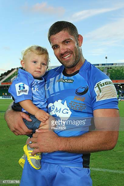 Matt Hodgson of the Force holds his son Hunter after playing his 100th Super Rugby game during the round four Super Rugby match between the Western...