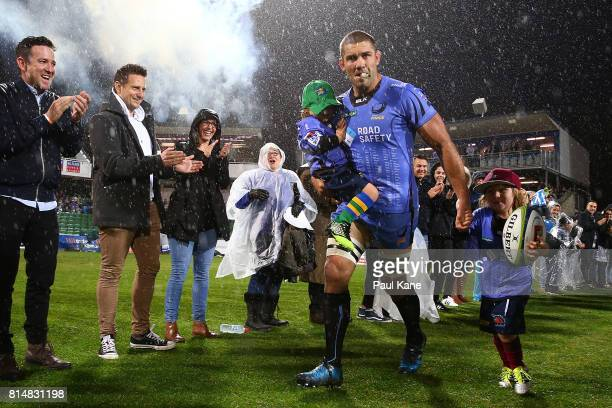 Matt Hodgson of the Force runs onto the field with his children Buddy and Hunter to play his final game during the round 17 Super Rugby match between...