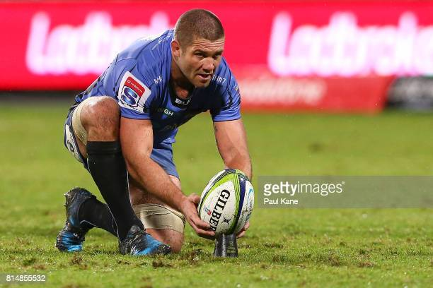 Matt Hodgson of the Force sets the ball on the kicking tee for a penalty kick during the round 17 Super Rugby match between the Force and the...