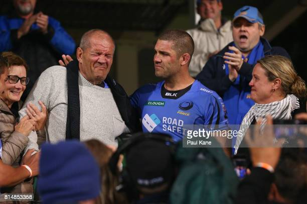 Matt Hodgson of the Force shares a moment with his father Max after playing his final game and winning the round 17 Super Rugby match between the...