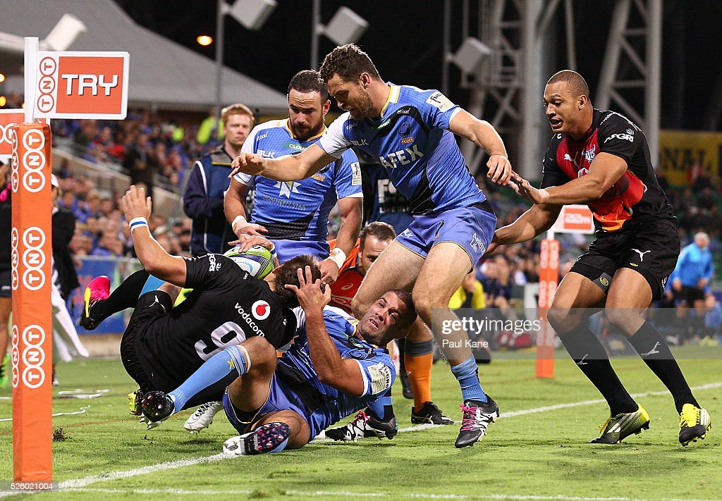 Matt Hodgson of the Force tackles Piet van Zyl of the Bulls during the round 10 Super Rugby match between the Force and the Bulls at nib Stadium on April 29, 2016 in Perth, Australia.