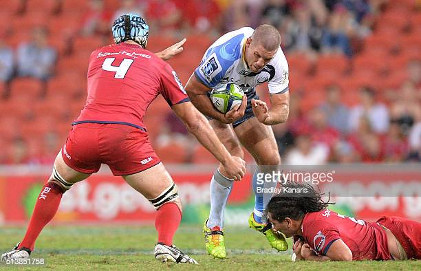 Matt Hodgson of the Force takes on the defence during the round two Super Rugby match between the Reds and the Force at Suncorp Stadium on March 5...