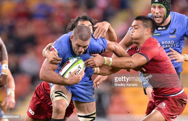 Matt Hodgson of the Western Force attempts to break away from the defence during the round 14 Super Rugby match between the Reds and the Force at...