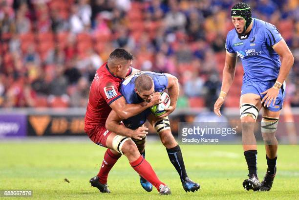 Matt Hodgson of the Western Force is tackled during the round 14 Super Rugby match between the Reds and the Force at Suncorp Stadium on May 26 2017...