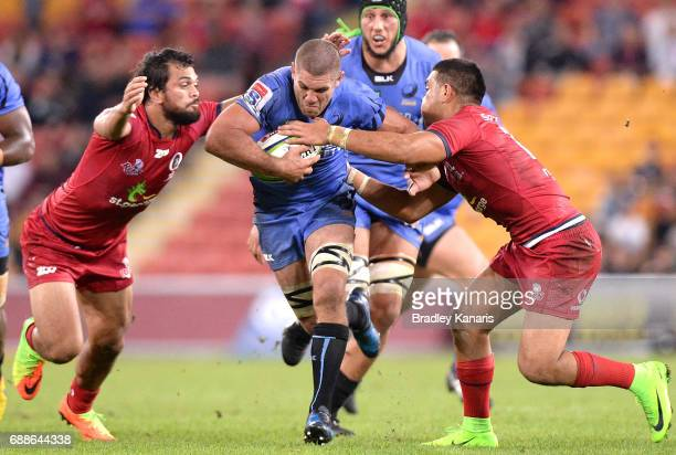Matt Hodgson of the Western Force takes on the defence during the round 14 Super Rugby match between the Reds and the Force at Suncorp Stadium on May...