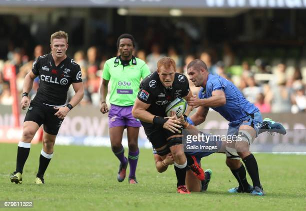 Matt Hodgson of Western Force looks to tackle Philip van der Walt of the Cell C Sharks during the Super Rugby match between Cell C Sharks and Force...