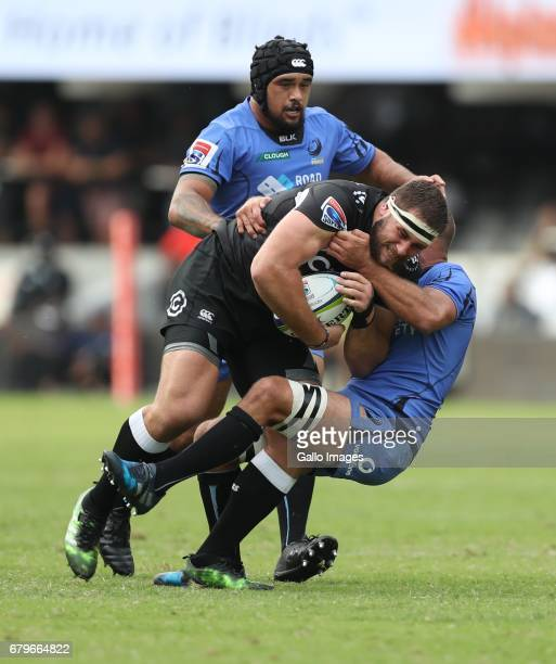 Matt Hodgson of Western Force tackling Thomas du Toit of the Cell C Sharks during the Super Rugby match between Cell C Sharks and Force at...