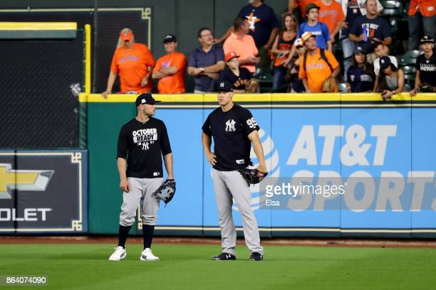 Matt Holliday and Aaron Judge of the New York Yankees talk in the outfield during batting practice prior to Game Six of the American League...