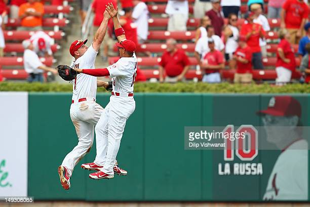 Matt Holliday and Jon Jay both of the St Louis Cardinals celebrate a victory over the Los Angeles Dodgers at Busch Stadium on July 26 2012 in St...