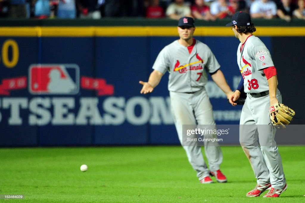 Matt Holliday #7 and Pete Kozma #38 of the St. Louis Cardinals react after the ball hits the grass as the infield fly rule is called in the eighth inning on a ball hit by Andrelton Simmons #19 of the Atlanta Braves during the National League Wild Card playoff game at Turner Field on October 5, 2012 in Atlanta, Georgia.
