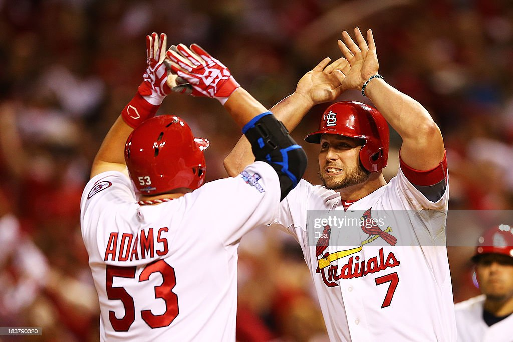 <a gi-track='captionPersonalityLinkClicked' href=/galleries/search?phrase=Matt+Holliday&family=editorial&specificpeople=207017 ng-click='$event.stopPropagation()'>Matt Holliday</a> #7 congratulates Matt Adams #53 of the St. Louis Cardinals on his two-run home run in the eighth inning against the Pittsburgh Pirates during Game Five of the National League Division Series at Busch Stadium on October 9, 2013 in St Louis, Missouri.