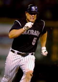 Matt Holliday of the Colorado Rockies chugs around second base on his way to third base in the 13th inning of the Rockies victory over the San Diego...