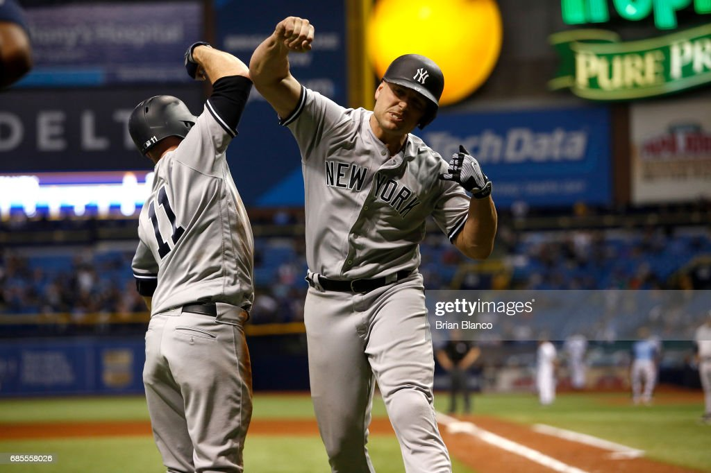 Matt Holliday #17 of the New York Yankees celebrates at home plate with Brett Gardner #11 after both scoring off of Holliday's two-run home run during the eighth inning of a game against the Tampa Bay Rays on May 19, 2017 at Tropicana Field in St. Petersburg, Florida.