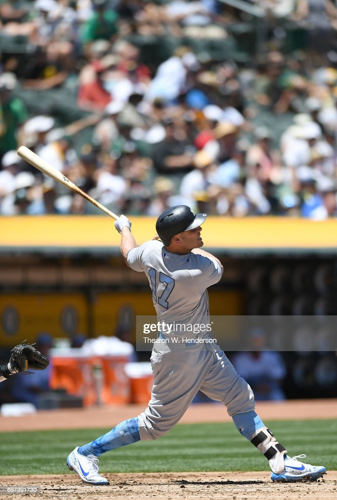 Matt Holliday #17 of the New York Yankees hits a solo home run against the Oakland Athletics in the top of the second inning at Oakland Alameda Coliseum on June 18, 2017 in Oakland, California.