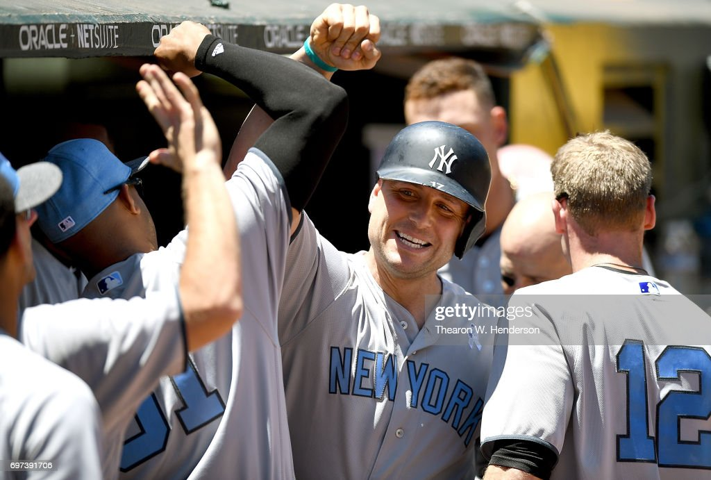 Matt Holliday #17 of the New York Yankees is congratulated by teammates after he hit a solo home run against the Oakland Athletics in the top of the second inning at Oakland Alameda Coliseum on June 18, 2017 in Oakland, California.