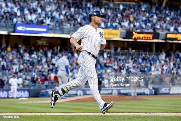Matt Holliday of the New York Yankees rounds the bases after a solo home run off of Danny Barnes of the Toronto Blue Jays during the seventh inning...