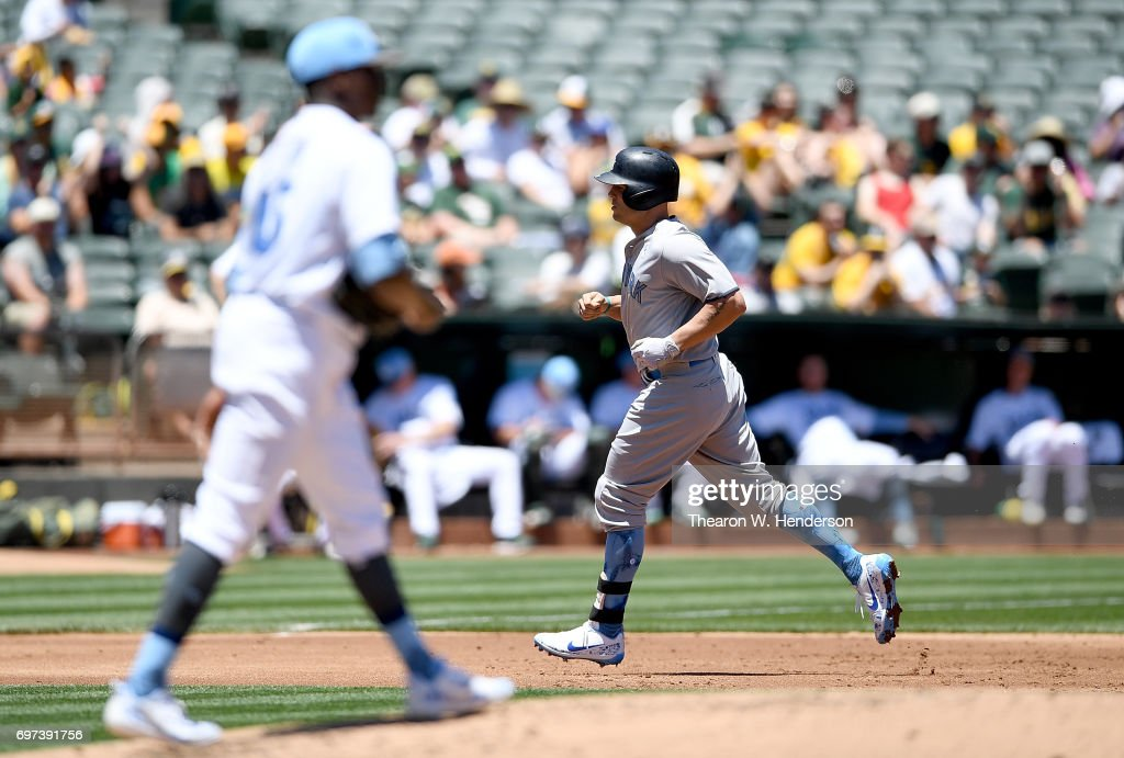 Matt Holliday #17 of the New York Yankees trots around the bases after hitting a solo home run off of Jharel Cotton #45 of the Oakland Athletics in the top of the second inning at Oakland Alameda Coliseum on June 18, 2017 in Oakland, California.