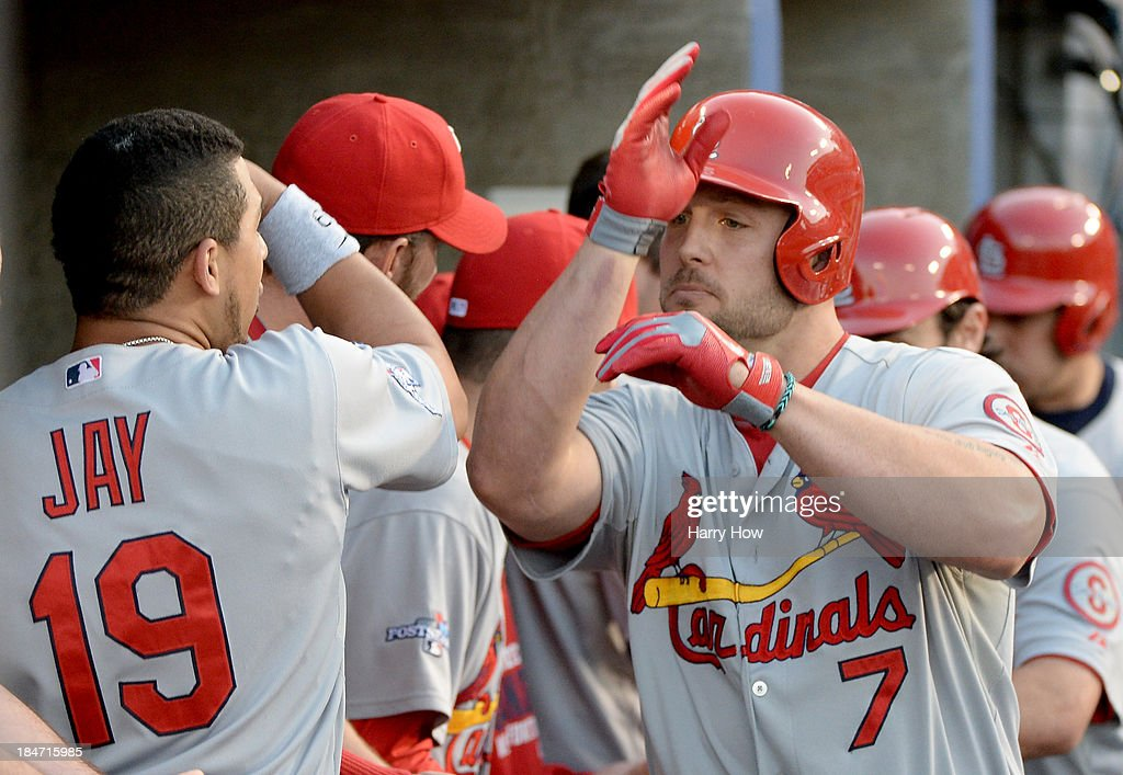 <a gi-track='captionPersonalityLinkClicked' href=/galleries/search?phrase=Matt+Holliday&family=editorial&specificpeople=207017 ng-click='$event.stopPropagation()'>Matt Holliday</a> #7 of the St. Louis Cardinals celebrates in the dugout with <a gi-track='captionPersonalityLinkClicked' href=/galleries/search?phrase=Jon+Jay+-+Baseball+Player&family=editorial&specificpeople=5734285 ng-click='$event.stopPropagation()'>Jon Jay</a> #19 after Holliday hits a two-run home run in the third inning against the Los Angeles Dodgers in Game Four of the National League Championship Series at Dodger Stadium on October 15, 2013 in Los Angeles, California.