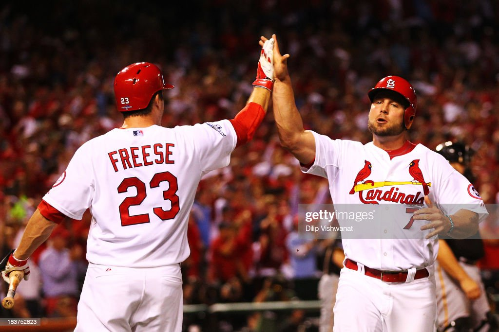 <a gi-track='captionPersonalityLinkClicked' href=/galleries/search?phrase=Matt+Holliday&family=editorial&specificpeople=207017 ng-click='$event.stopPropagation()'>Matt Holliday</a> #7 of the St. Louis Cardinals celebrates with <a gi-track='captionPersonalityLinkClicked' href=/galleries/search?phrase=David+Freese+-+Baseball+Player&family=editorial&specificpeople=4948315 ng-click='$event.stopPropagation()'>David Freese</a> #23 as he scores on a single hit by Jon Jay in the sixth inning against the Pittsburgh Pirates during Game Five of the National League Division Series at Busch Stadium on October 9, 2013 in St Louis, Missouri.