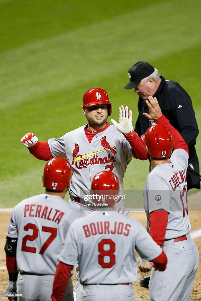 Matt Holliday #7 of the St. Louis Cardinals celebrates with teammates after hitting a three-run homer in the eighth inning of the game against the Cleveland Indians at Progressive Field on May 12, 2015 in Cleveland, Ohio.