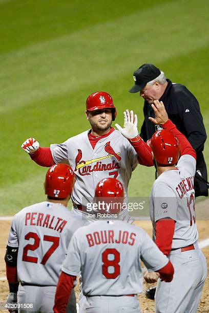 Matt Holliday of the St Louis Cardinals celebrates with teammates after hitting a threerun homer in the eighth inning of the game against the...