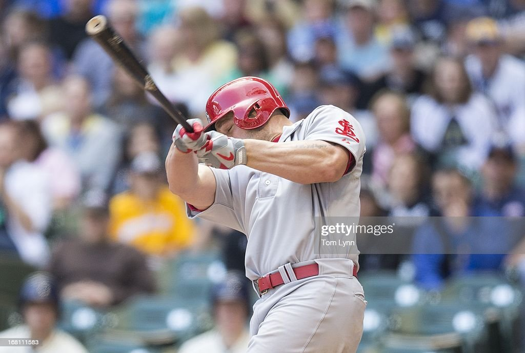 <a gi-track='captionPersonalityLinkClicked' href=/galleries/search?phrase=Matt+Holliday&family=editorial&specificpeople=207017 ng-click='$event.stopPropagation()'>Matt Holliday</a> #7 of the St Louis Cardinals connects for a two RBI home run off of Marco Estrada of the Milwaukee Brewers during the fourth inning at Miller Park on May 5, 2013 in Milwaukee, Wisconsin.