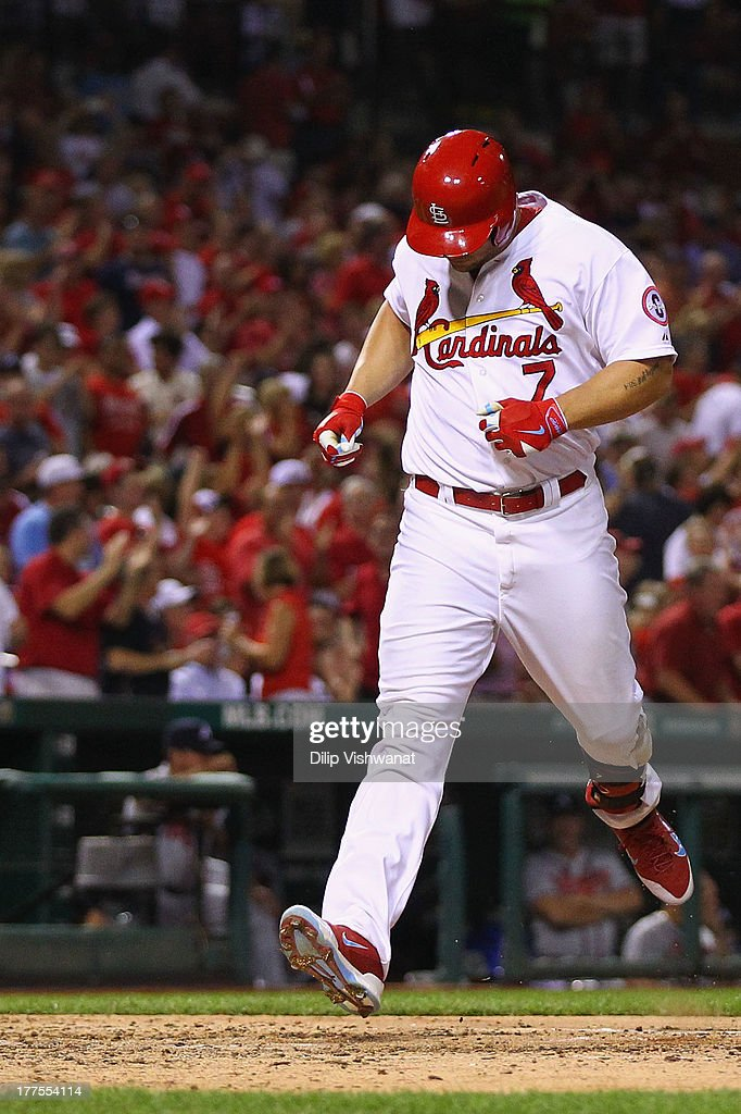 <a gi-track='captionPersonalityLinkClicked' href=/galleries/search?phrase=Matt+Holliday&family=editorial&specificpeople=207017 ng-click='$event.stopPropagation()'>Matt Holliday</a> #7 of the St. Louis Cardinals crosses home plate after hitting a solo home run against the Atlanta Braves in the sixth inning at Busch Stadium on August 23, 2013 in St. Louis, Missouri.